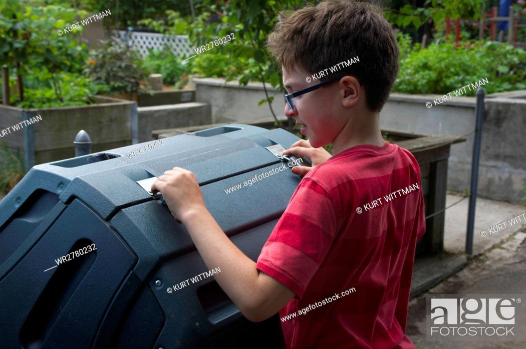 Stock Photo: Boy Working with Compost Bins in Community Garden.