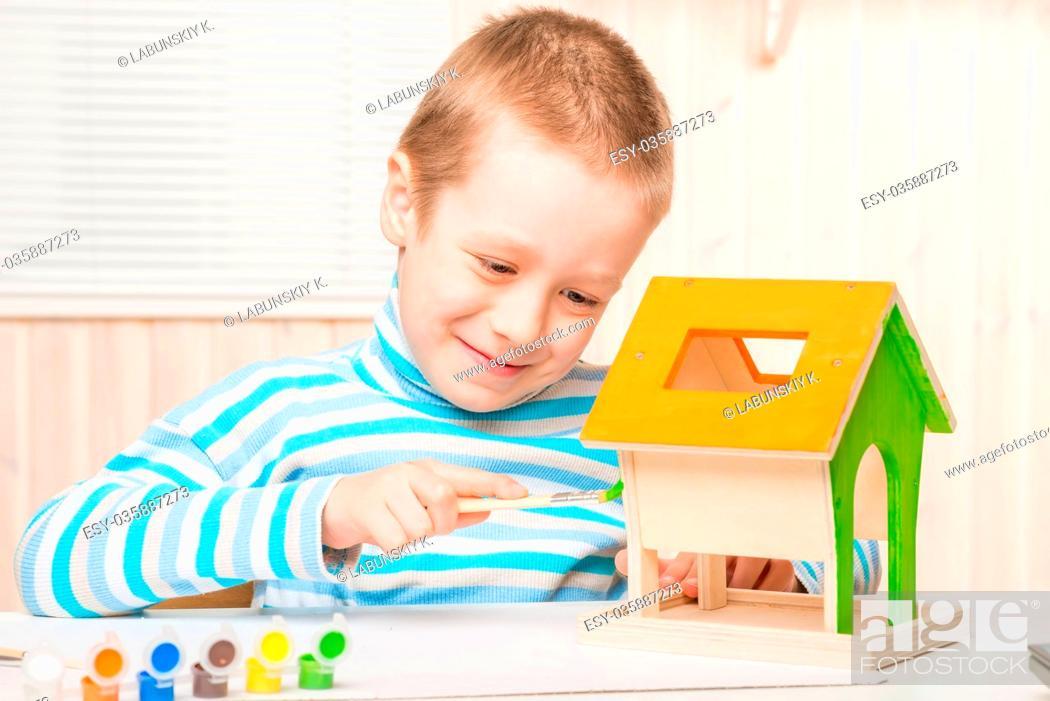 Pleasant Happy Boy Is Preparing A Bird Feeder Her Paint Stock Photo Download Free Architecture Designs Scobabritishbridgeorg