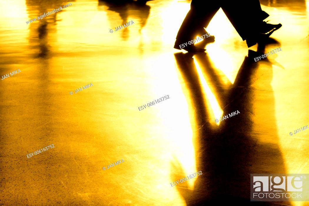 Stock Photo: Abstract creative photo of people silhouettes of walking people and their shadows on golden background.