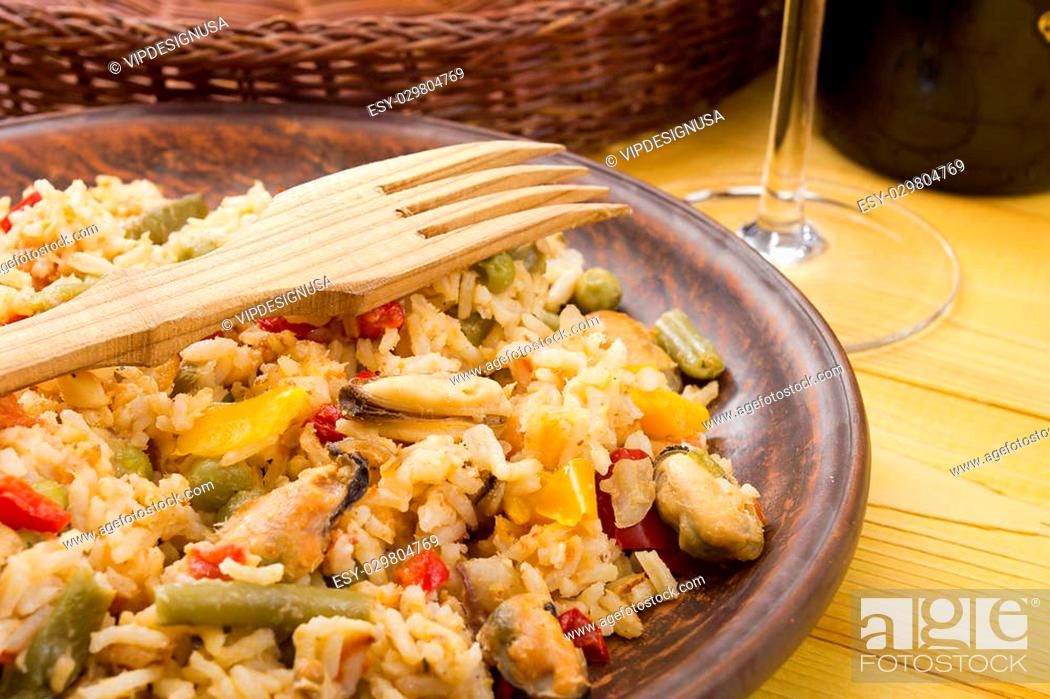 Stock Photo: National dish of Spain - Fish paella. A dish which uses the spice saffron.