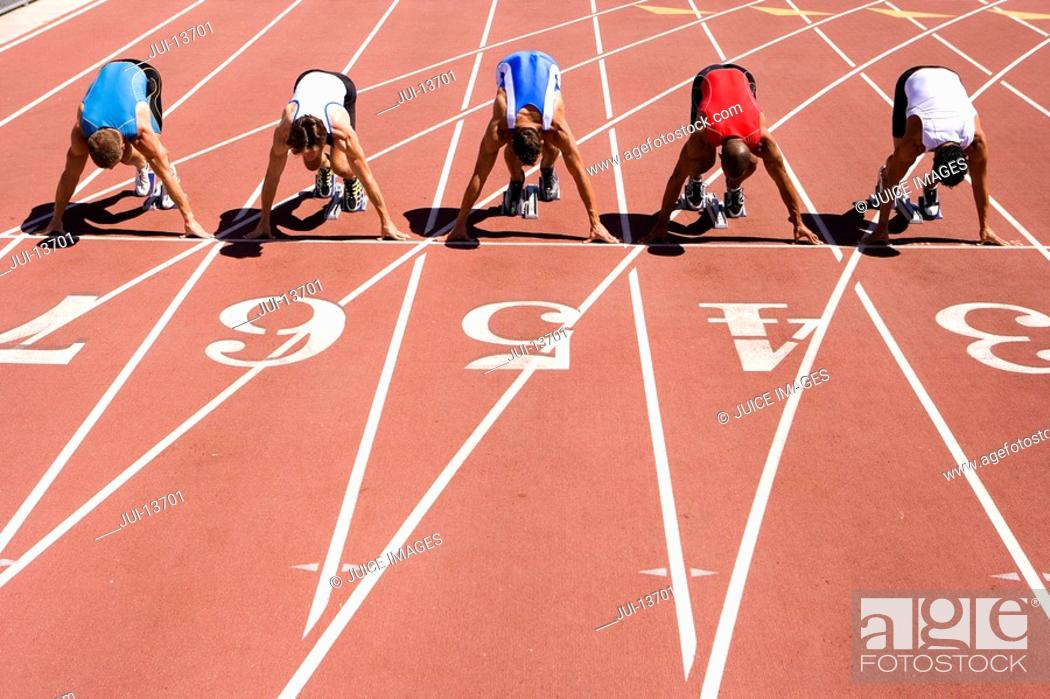 Stock Photo: Male sprinters on starting blocks, elevated view.