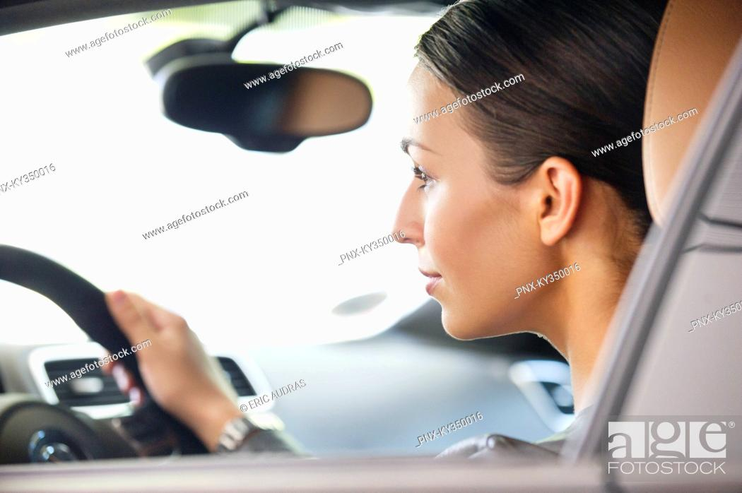 Stock Photo: Young woman taking a test drive.