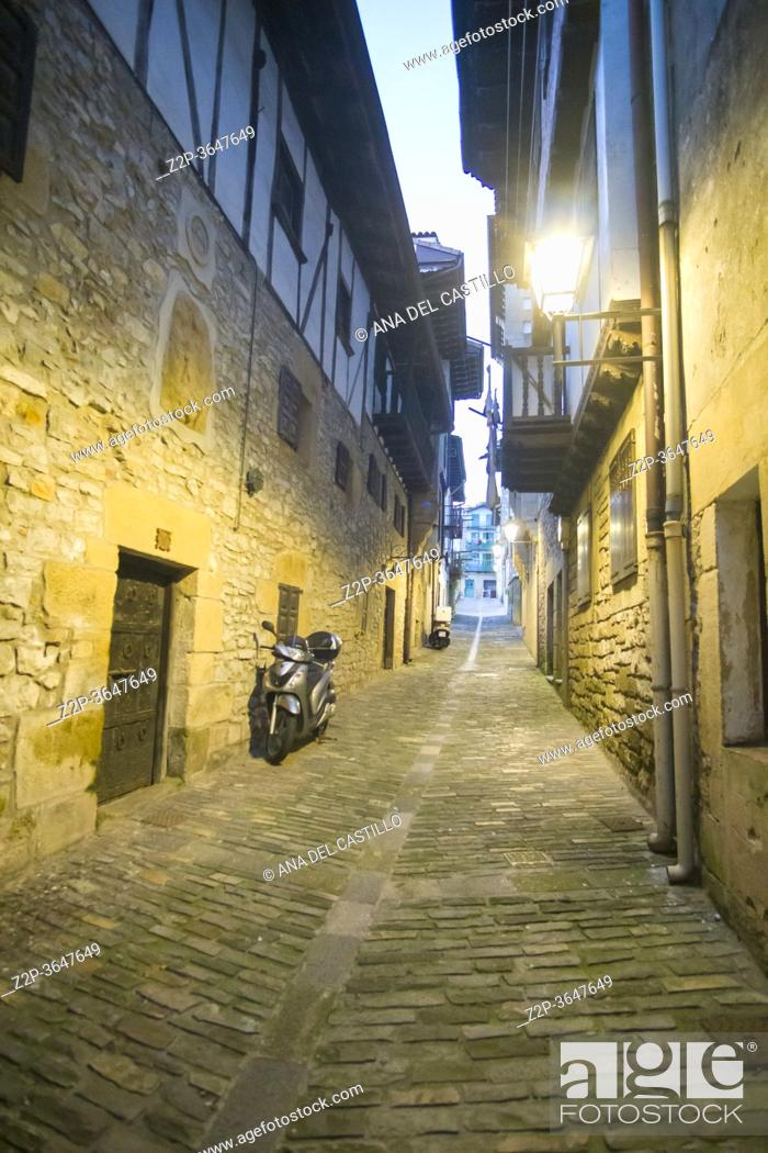 Stock Photo: Hondarribia, a town in Gipuzkoa, Spain on July 23, 2020: The medieval city by dusk.