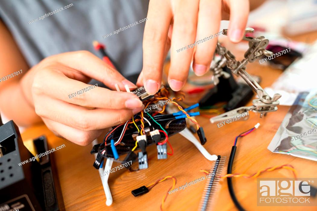 Stock Photo: Human combine the drone cable.