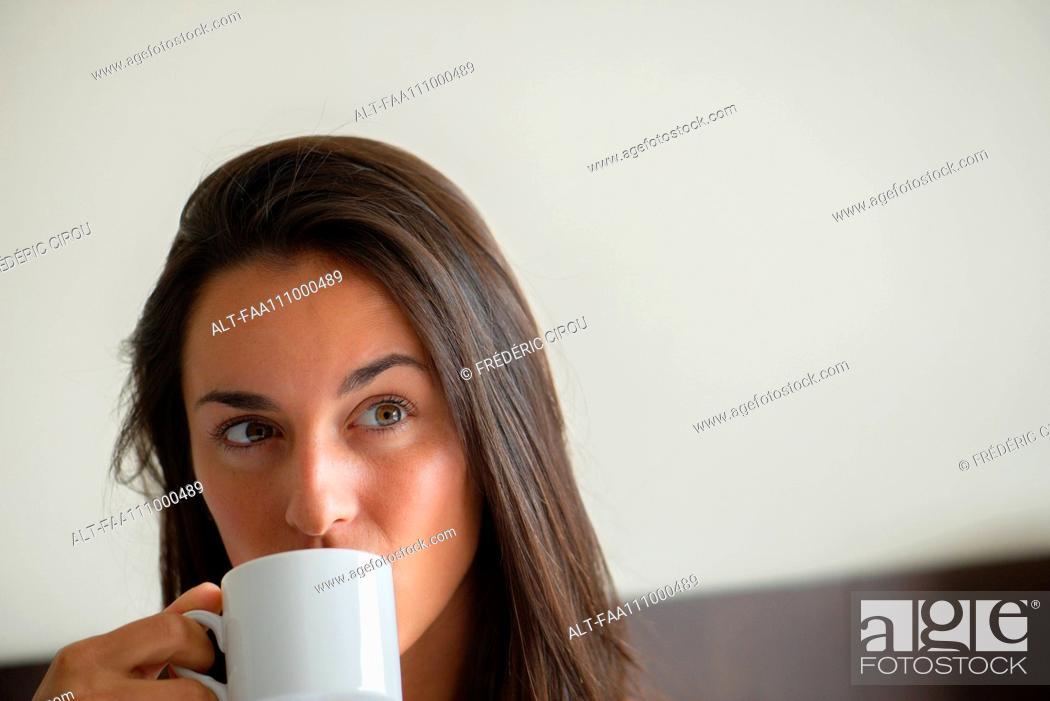 Stock Photo: Woman drinking coffee.