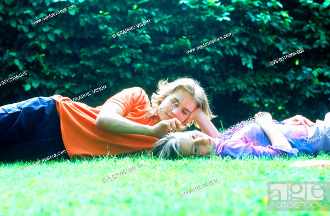 Stock Photo: Young couple lying in the grass together.