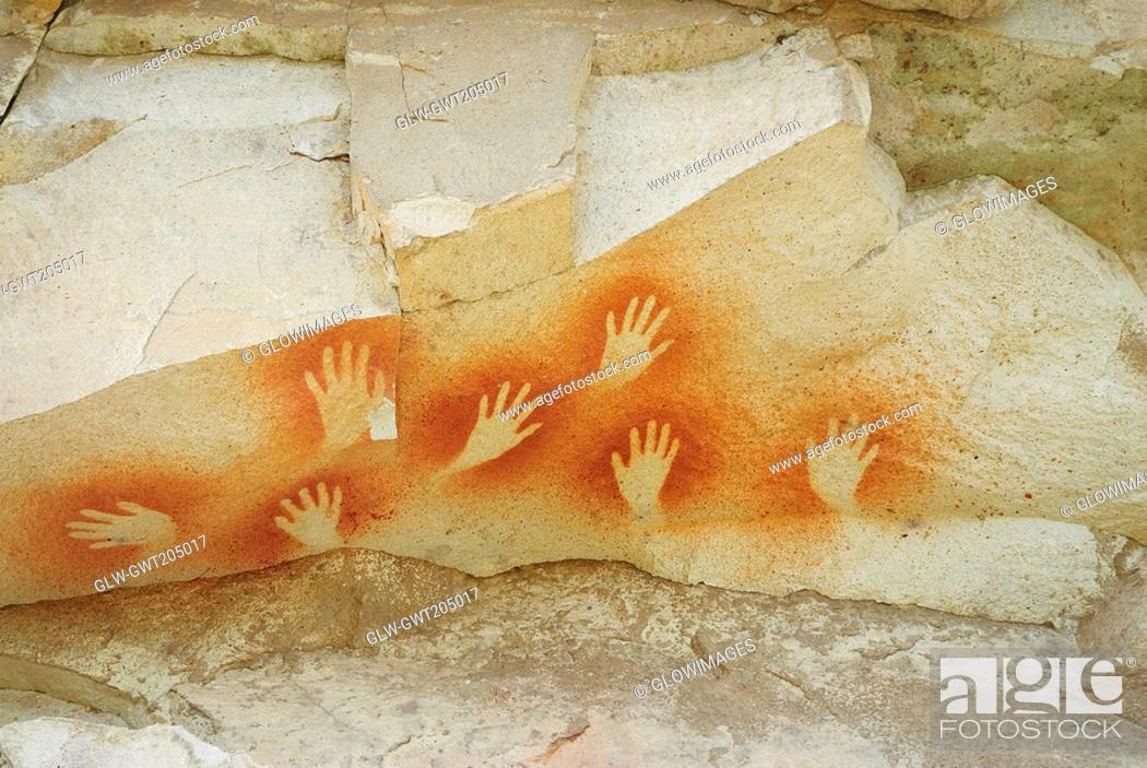 Stock Photo: Hand signs on a rock, Cave of the Hands, Pinturas River, Patagonia, Argentina.