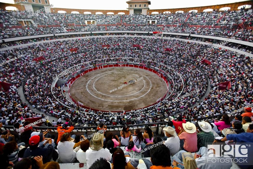 Stock Photo: Spectators watching a bullfight in a bullring, Plaza De Toros San Marcos, Aguascalientes, Mexico.
