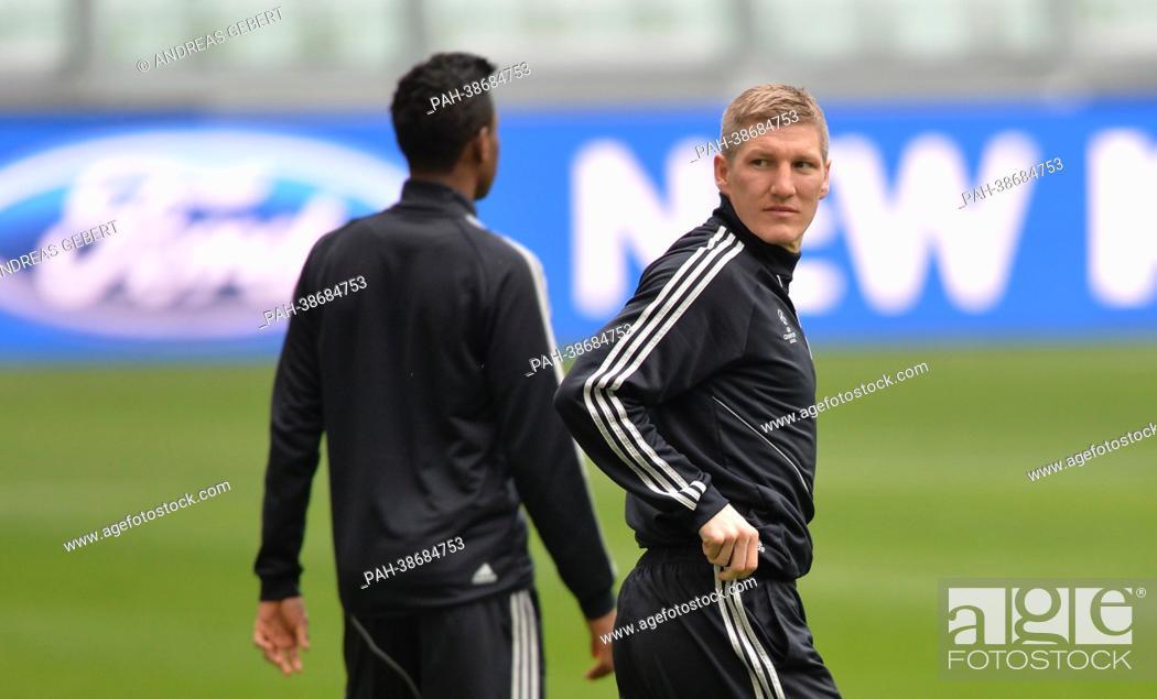 Bastian Schweinsteiger of FC Bayern Munich take part in the