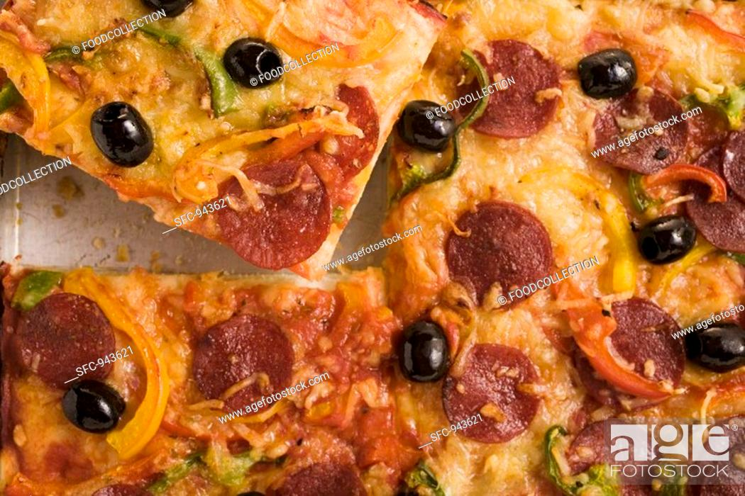 Stock Photo: Salami pizza with peppers and olives.