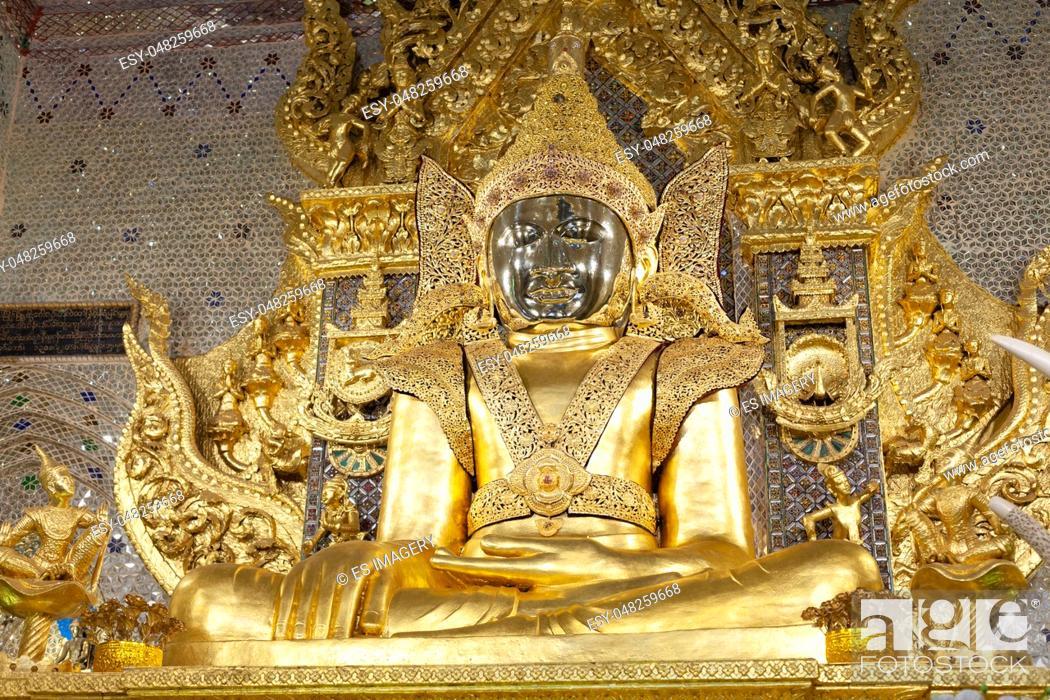 Stock Photo: Golden statue of the Buddha at Mahamuni Paya (Mahar Myatmuni image) temple in Mawlamyine.