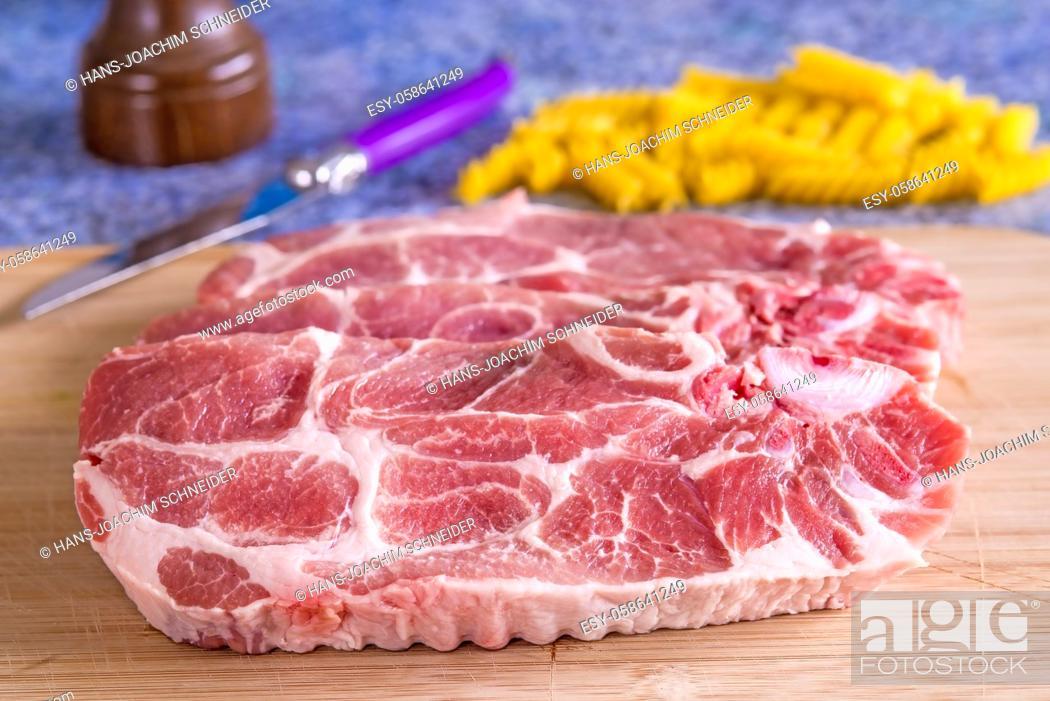 Stock Photo: raw pork chop in a closeup.