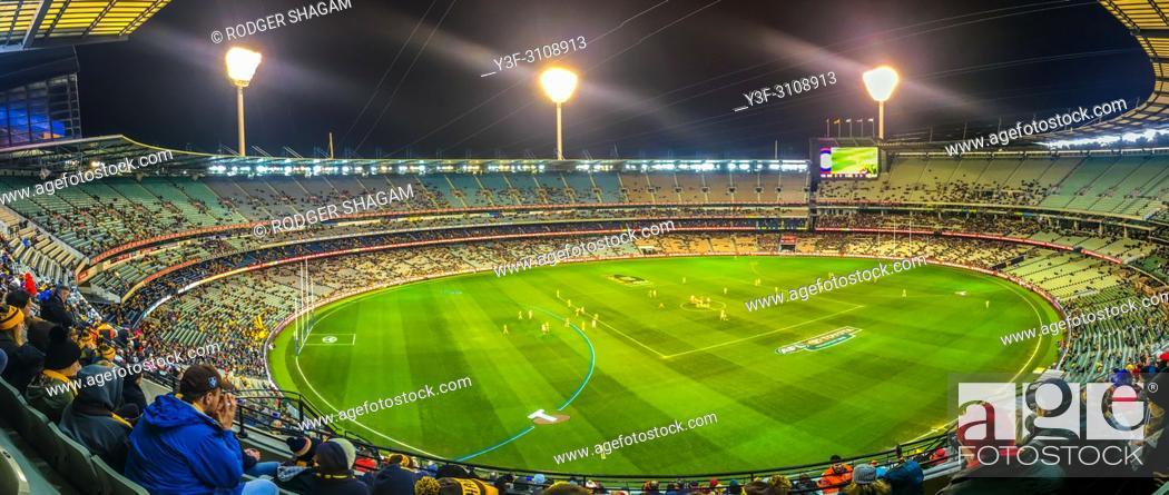 Stock Photo: An Australian Footie Game in progress. Melbourne, Australia.