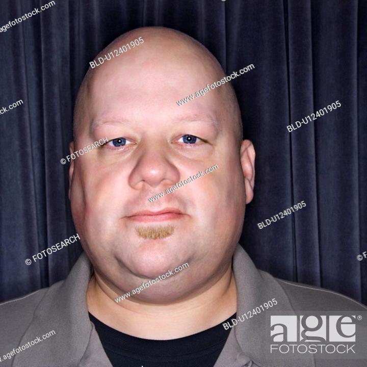 Stock Photo: Bald man looking at viewer.