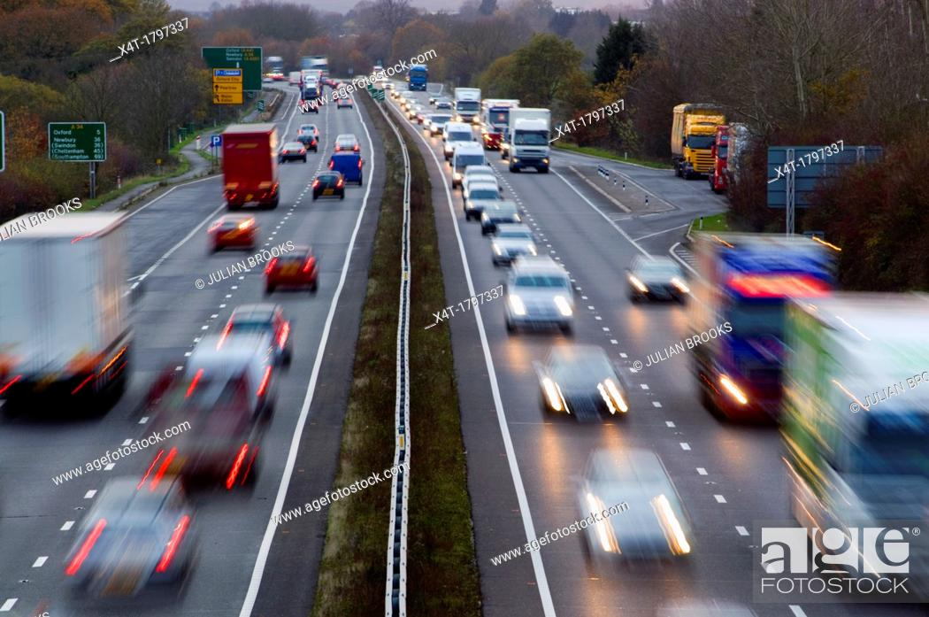 Stock Photo: light trails at dusk on the A34.