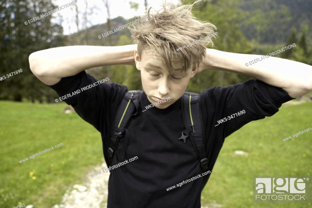 Stock Photo: Young boy in countryside. Bad Tölz, Upper bavaria, Germany.
