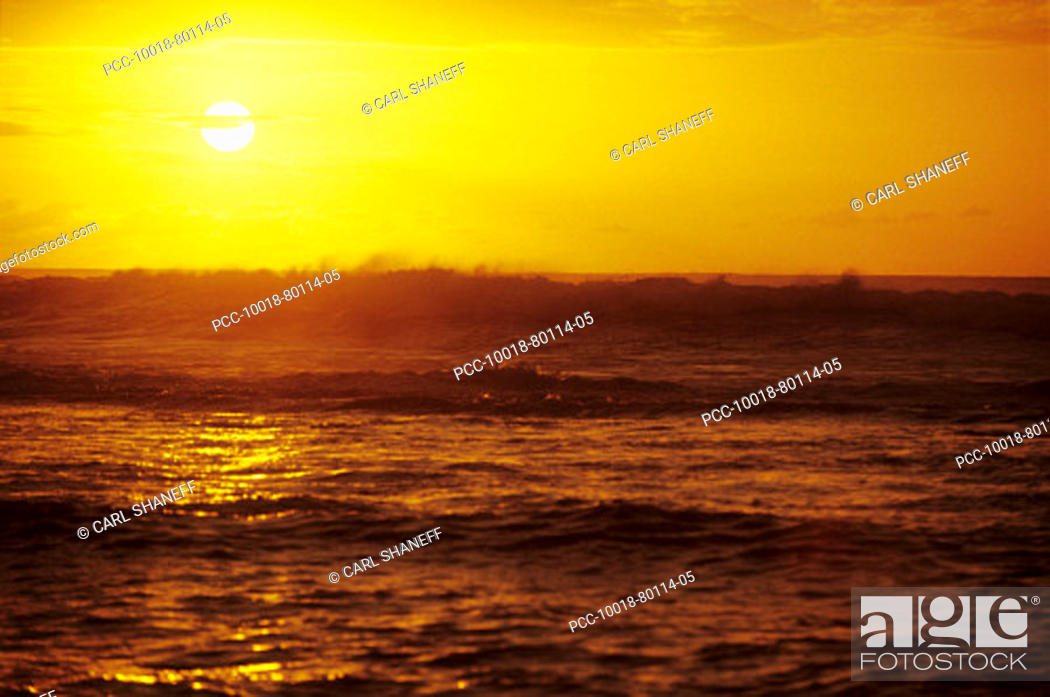 Stock Photo: Dramatic yellow sunset sky over the ocean.
