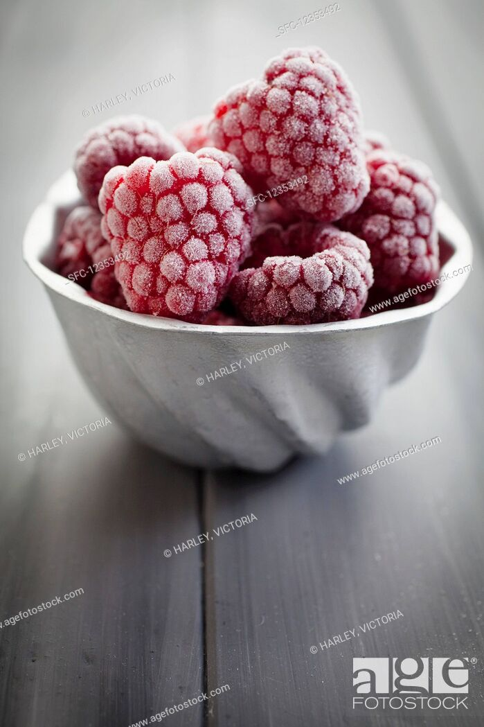 Stock Photo: Vintage aluminium mould filled with frozen raspberries.
