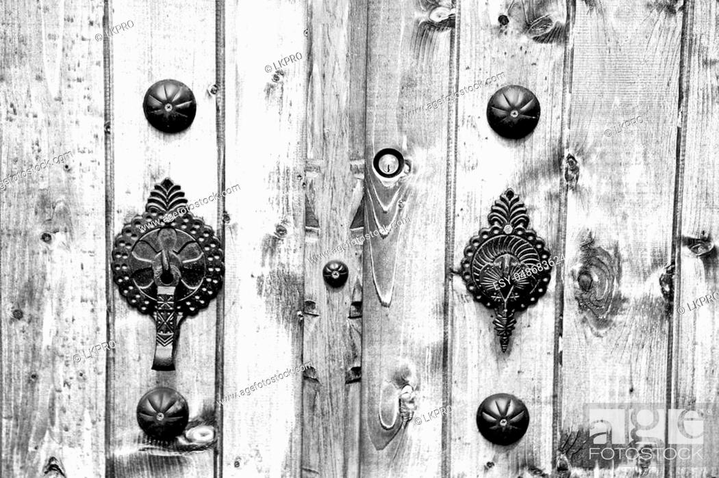 Stock Photo: blur in iran antique door entrance and decorative handle for background.