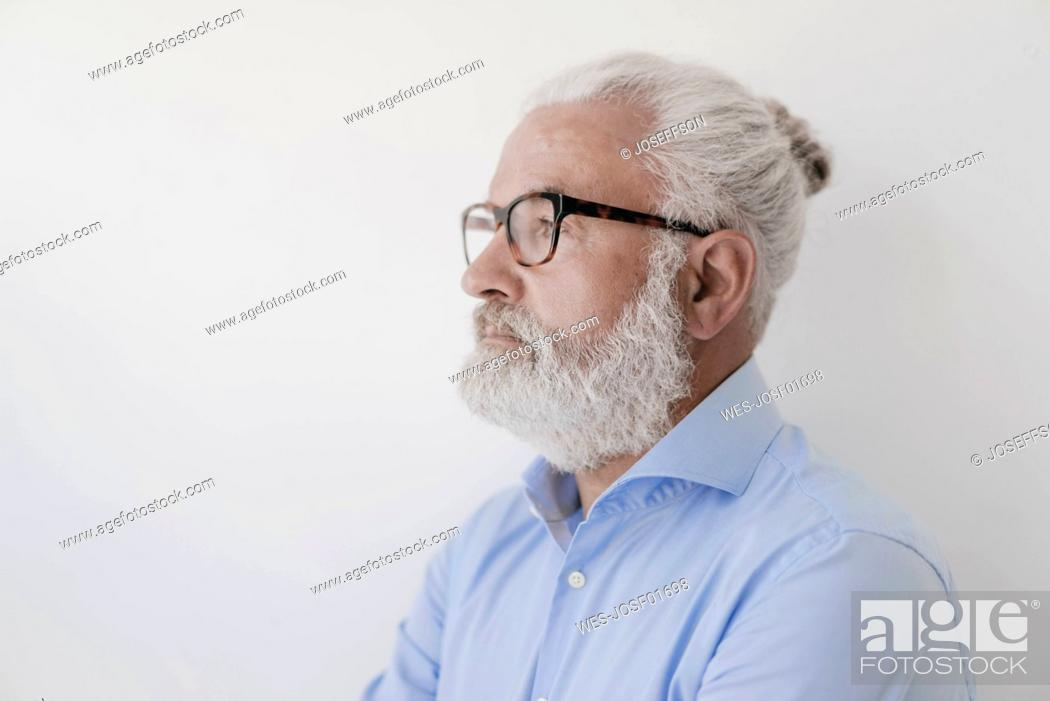 Stock Photo: Portrait of serious mature man with beard and glasses.