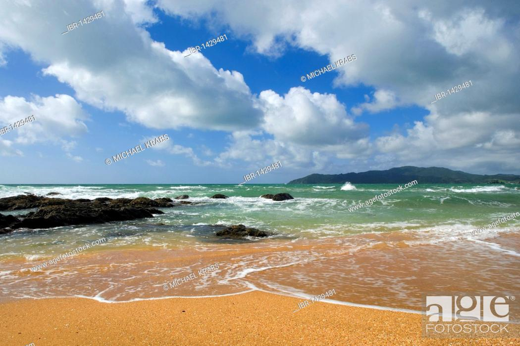 Stock Photo: Waves on the orange-red beach of Cable Bay, Doubtless Bay, Northland, North Island, New Zealand.