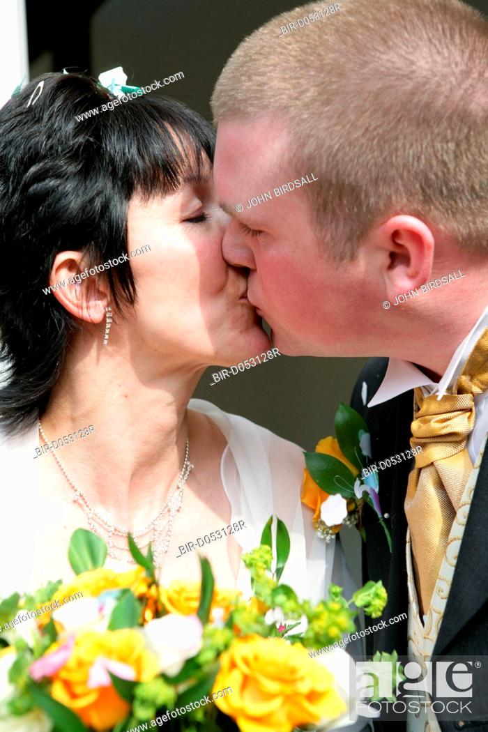 Stock Photo Bride And Groom Kiss Each Other After Taking Marriage Vows At A Registry Office Wedding