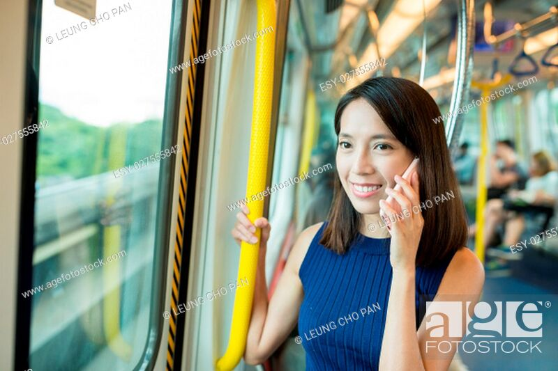 Stock Photo: Woman talk to cellphone inside train compartment.