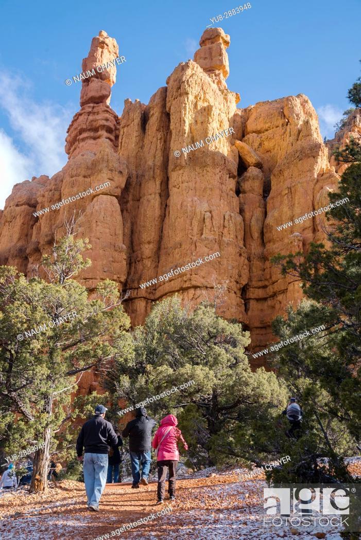 Stock Photo: Group of tourists near famous Hoodoos mountain, Red Canyon, Utah, USA.