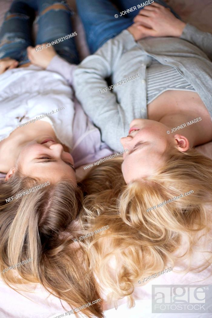 Stock Photo: Girls lying on bed.