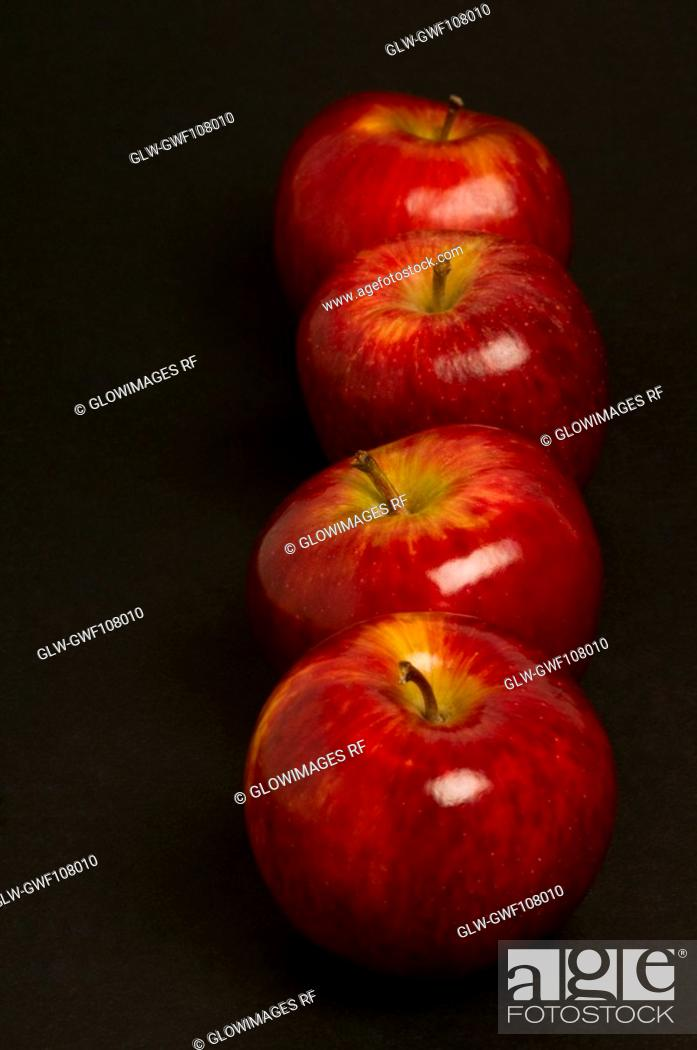 Stock Photo: Close-up of apples in a row.