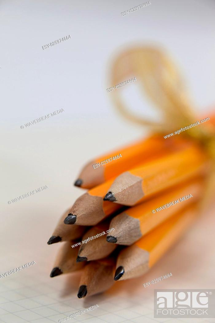 Stock Photo: Bunch of pencils wrapped with ribbons.