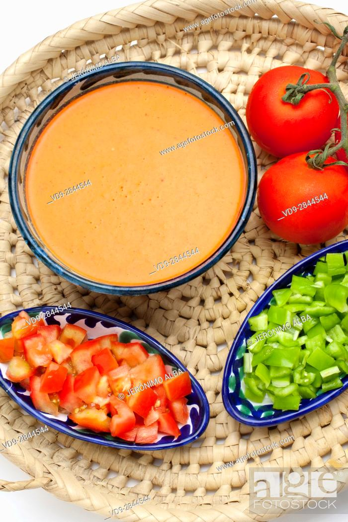 Stock Photo: Food. Traditional Andalusian gazpacho with its ingredients. Tomato and green pepper. Andalusia, Spain. Europe.