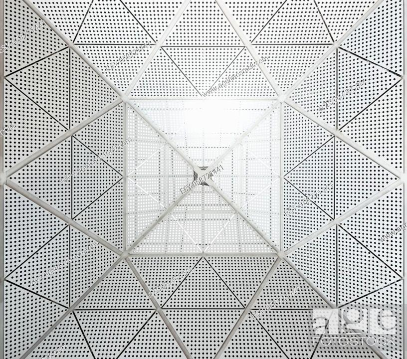 Stock Photo: Modern metal ceiling dotted pattern. Sunlight entering the building from the top part of the roof.