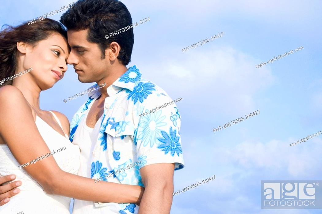 side profile of a young couple romancing stock photo picture and