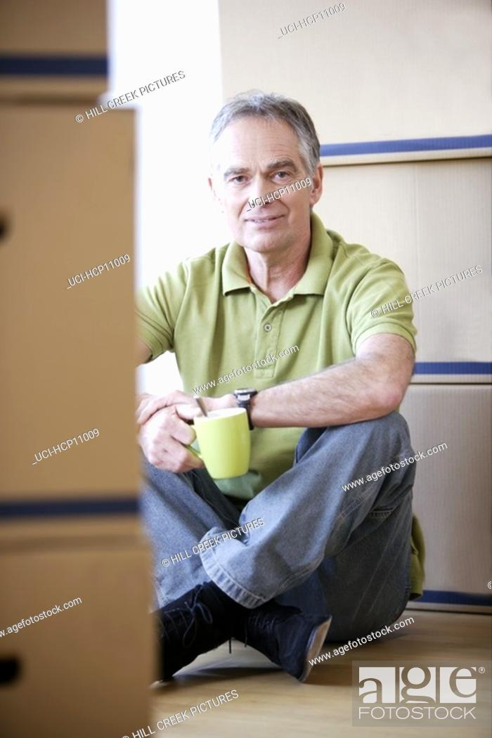 Stock Photo: Man relaxing with coffee cup.
