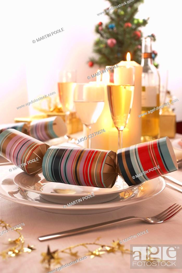 Stock Photo: Place setting with Christmas cracker.
