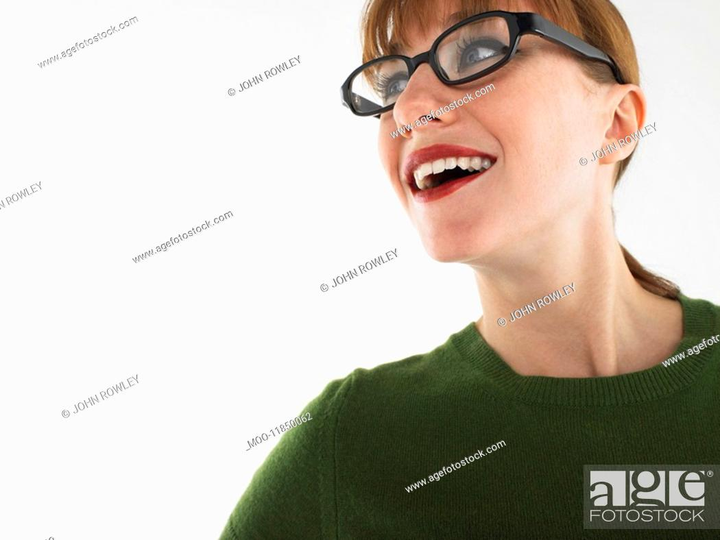 Stock Photo: Woman in studio wearing glasses head and shoulders.