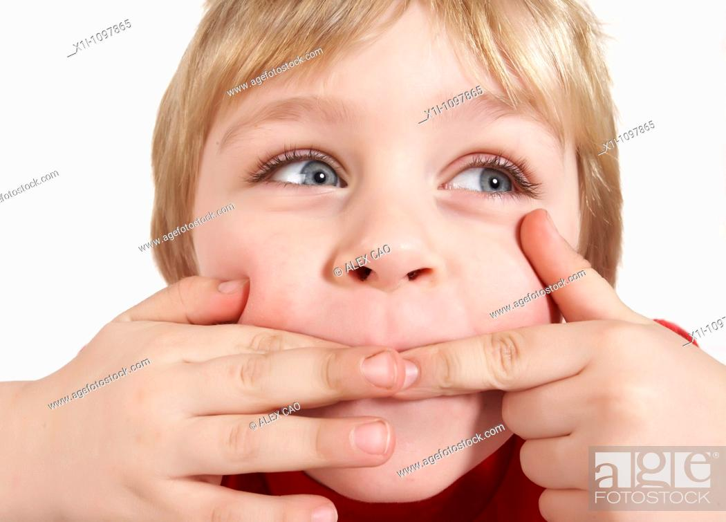 Stock Photo: Little boy pulling a face.