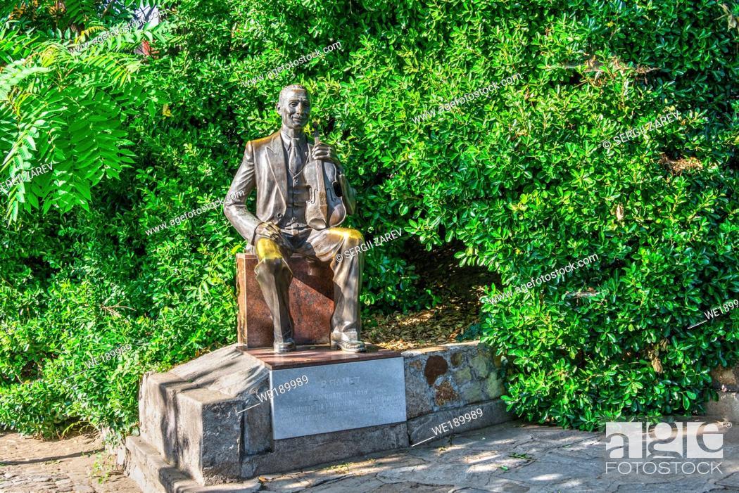 Stock Photo: Plovdiv, Bulgaria - 07. 24. 2019. Statue of Sasho Nikolov-Sladura in Plovdiv, Bulgaria, on a sunny summer day.