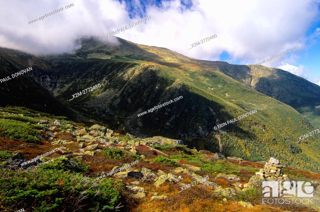 Stock Photo: Tuckerman Ravine (left) Mount Washington (top) and Huntington Ravine straight ahead to the right engulfed in cloud cover from along the Boott Spur Trail in the.