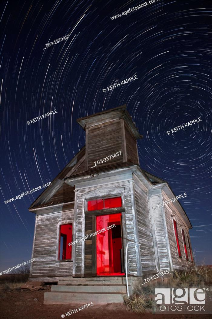 Stock Photo: Abandoned Taiban Presbyterian Church in New Mexico at night with star trails.
