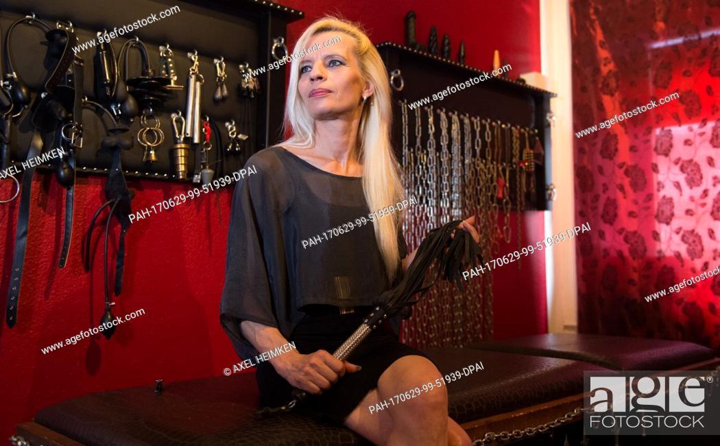 Stock Photo - The professional dominatrix