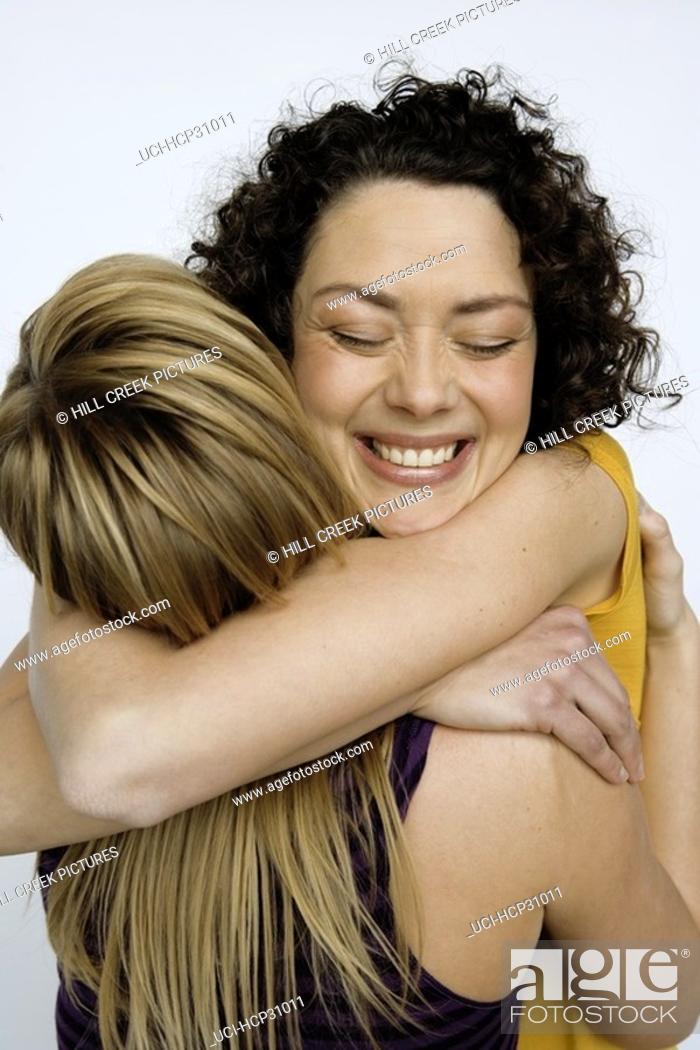 Stock Photo: Young women hugging.