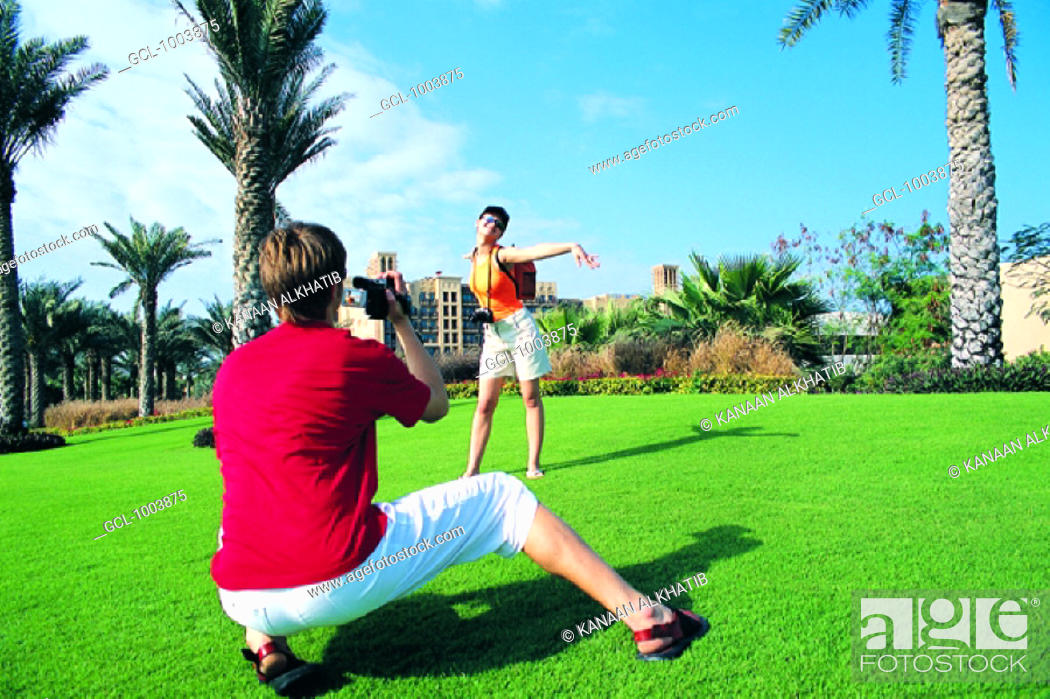 Stock Photo: Western tourists photographing in front of Mina Al Salam hotel, Dubai, United Arab Emirates.