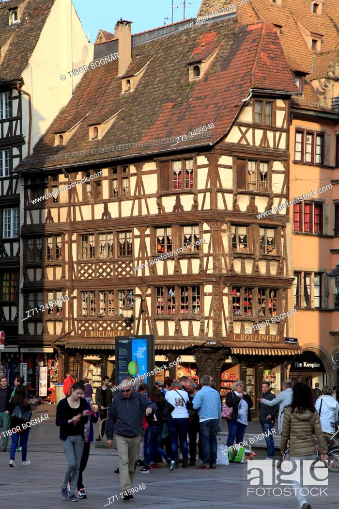 Stock Photo: France, Alsace, Strasbourg, street scene, typical architecture, people.