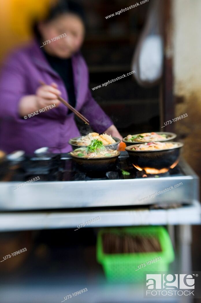 Stock Photo: One of many small owned family restaurants seen throughout China.