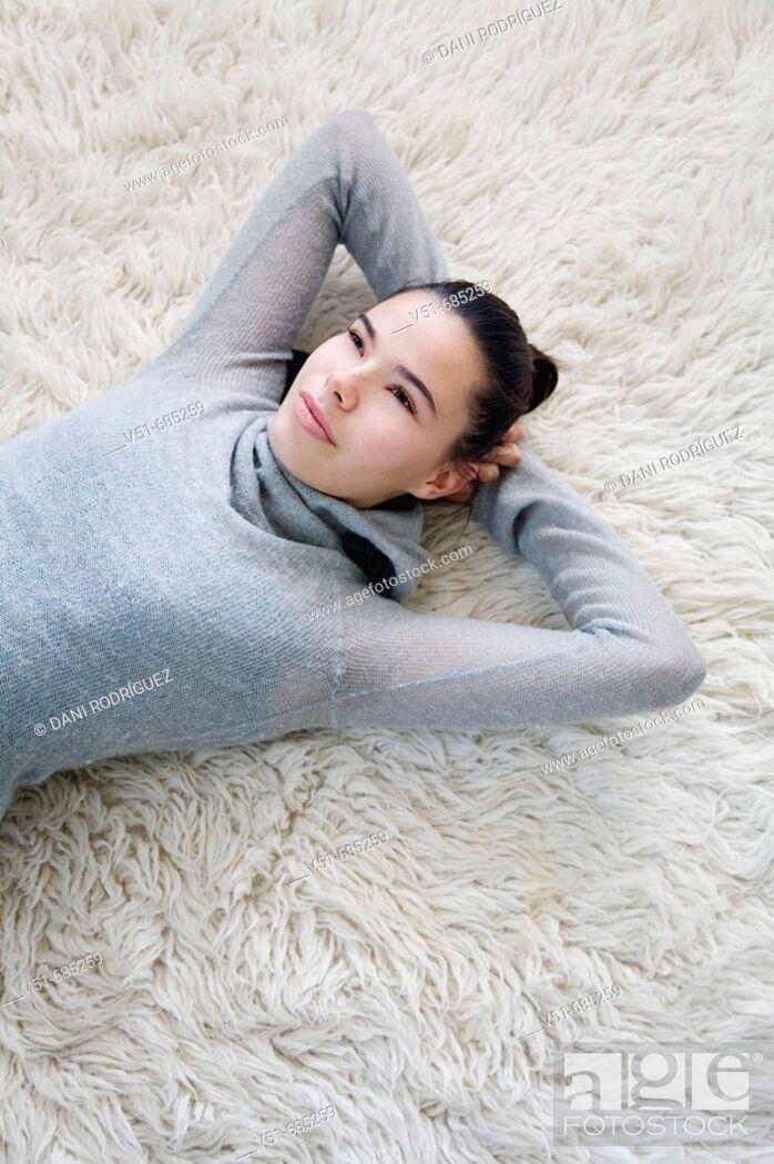 Stock Photo: Teenage girl daydreaming at home.