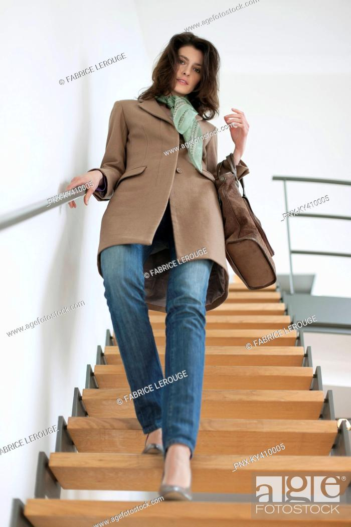 Stock Photo: Woman moving down stairs.