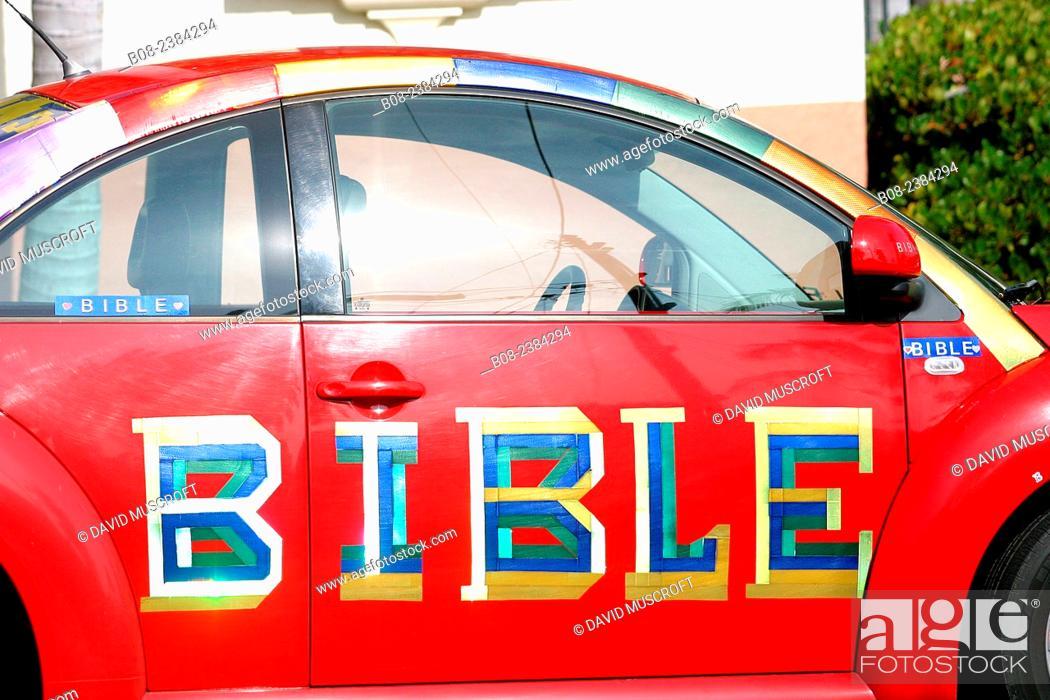 Stock Photo: car with bible written on it, Santa Barbara, Califiornia, USA.