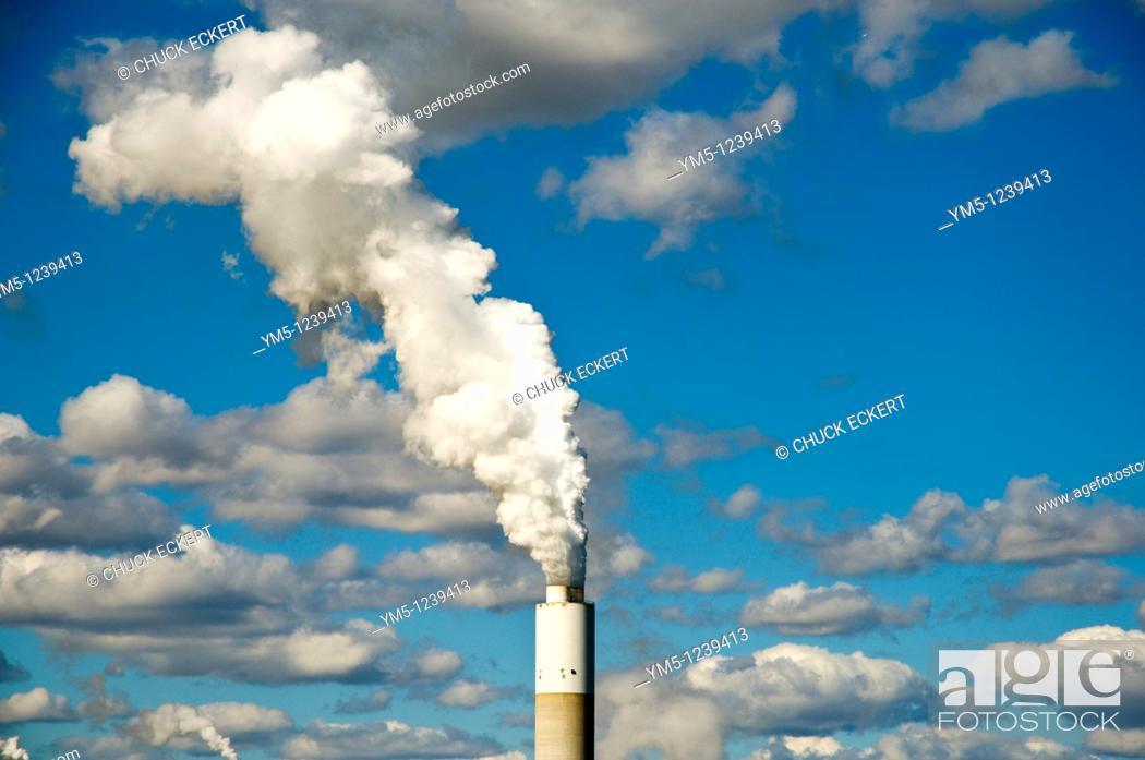 Stock Photo: Smokestack blowing smoke in Southern Wisconsin, USA.